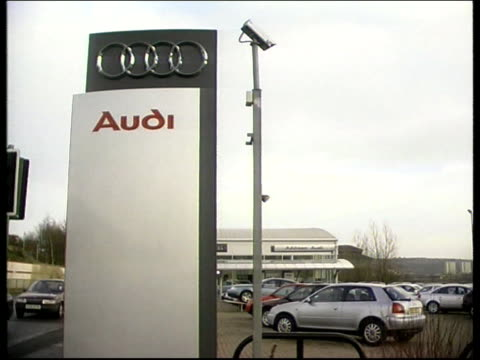 British motorists still overcharged for their motors LIB Cars on forecourt of Audi dealership Sign outside Audi dealership Sign in dealer's window...