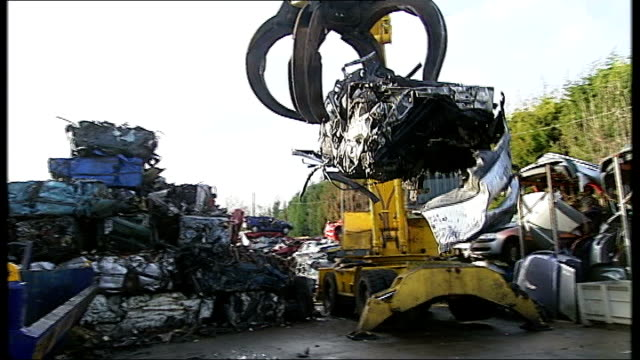 car scrap yard general views close shot of scrapyard claw driver driving crane / general views of claw removing crushed car from crusher and... - pile driver stock videos & royalty-free footage