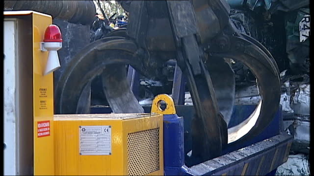 car scrap yard general views more general views of scrapyard claw crane picking up cars and placing in crusher / genral views of crusher crushing... - yard measurement stock videos and b-roll footage