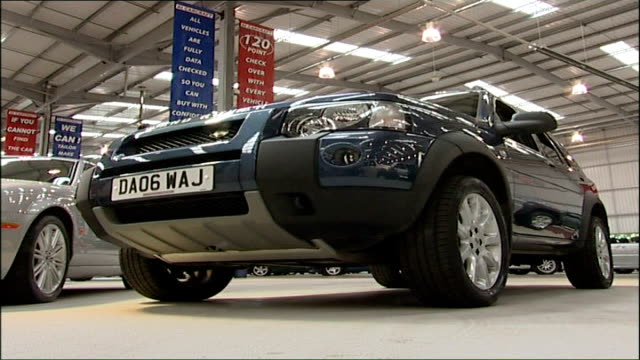 ford planning to sell off jaguar; midlands: landrover on display in factory front seats and dashboard of landrover car - land rover stock videos & royalty-free footage
