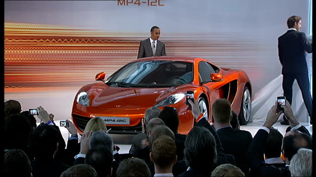 mclaren supercar launch: lewis hamilton and jenson button unveil car; england: surrey: woking: int lewis hamilton and jenson button sitting on stage... - see other clips from this shoot 412 stock videos & royalty-free footage