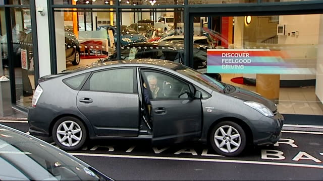 stockvideo's en b-roll-footage met toyota car showroom england london edgware road ext various general views of toyota car dealer showroom / toyota cars in showroom / mechanics working... - toyota motor