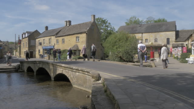 motor museum and river windrush, bourton on the water, cotswolds, gloucestershire, england, united kingdom, europe - windrush river stock videos and b-roll footage