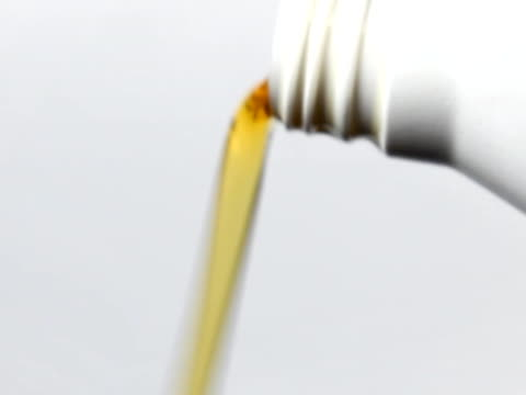 motor oil pouring from plastic bottle - motor oil stock videos and b-roll footage