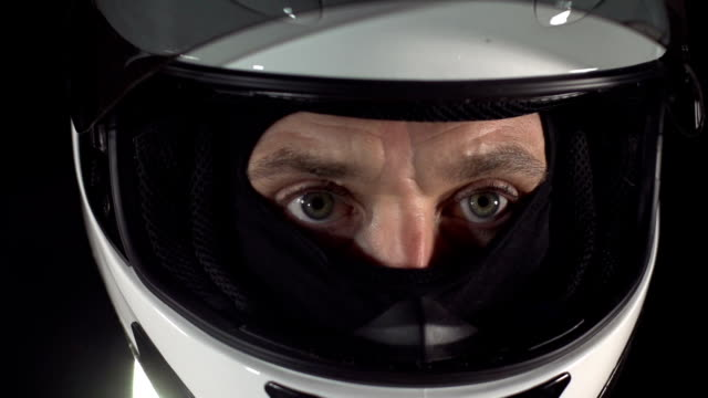motor racing / formula one motorbike driver visor close up - work helmet stock videos & royalty-free footage