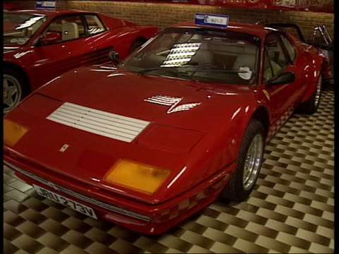 Nigel Mansell ENGLAND Dorset Blandford Forum MS Inside of Ferrari car dealership owned by Nigel Mansell with cars on show PAN LR CMS Mansell across...