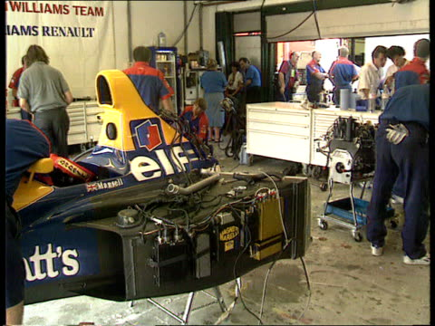 Nigel Mansell INT MS Mechanics around disassembled car CMS Mechanic working on car PULL OUT another