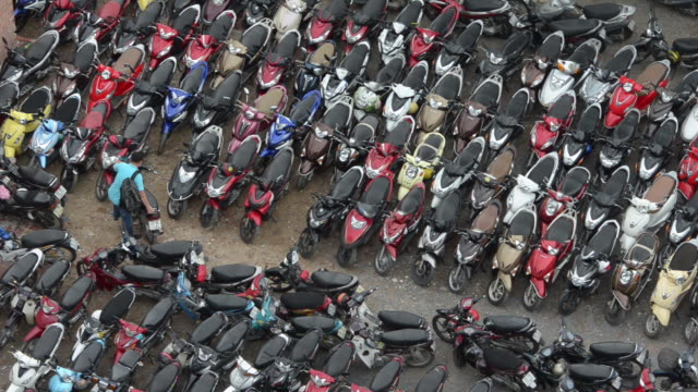 stockvideo's en b-roll-footage met motor scooters parked in large parking area in district 1, ho chi minh city, vietnam - scooter