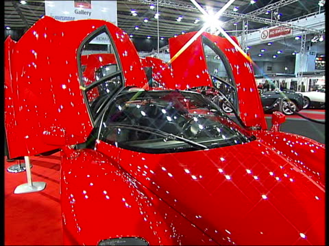 mph '06 motor show at earls court shot of ferrari interior / more general views of luxury cars and visitors at exhibition some motors exposed - earls court stock videos & royalty-free footage
