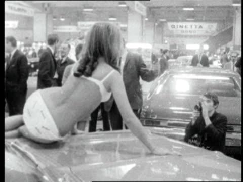 motor show; england: london: earl's court: michael nicholson situationer sof model on bonnet of car wearing bikini cars turn on displays 55337 - swimwear stock videos & royalty-free footage