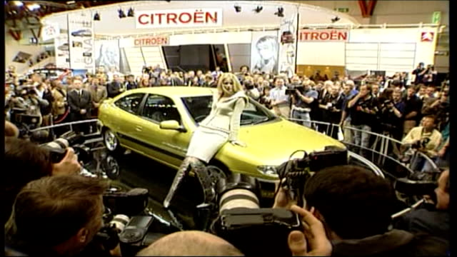 motor show poster controversy lib earls court supermodel claudia schiffer posing on citreon car - earls court stock videos & royalty-free footage