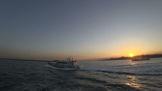 Motor Yacht and Transportation Ship At The Sunset