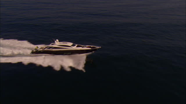 low aerial, motor yacht crossing ocean, near newport, rhode island, usa - yacht stock videos & royalty-free footage