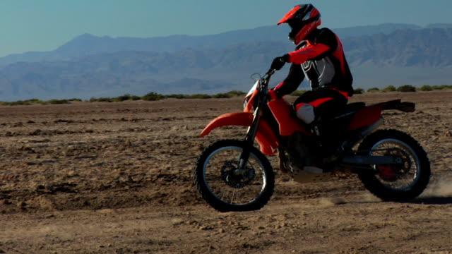 motorbike coming towards in desert - baja california peninsula stock videos & royalty-free footage