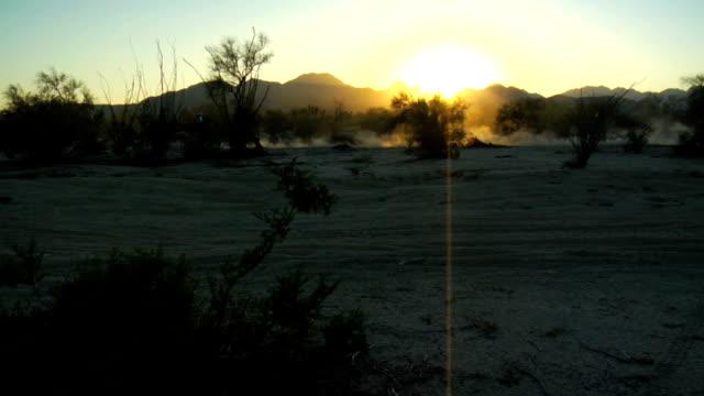 motorbike dust silhouette - baja california peninsula stock videos and b-roll footage