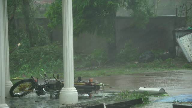 motorbike knocked over by powerful wind of super typhoon mangkhut as it hit the philippines - damaged stock videos & royalty-free footage