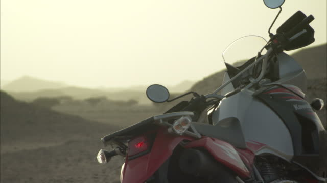 A motorbike parked in the desert. Available in HD
