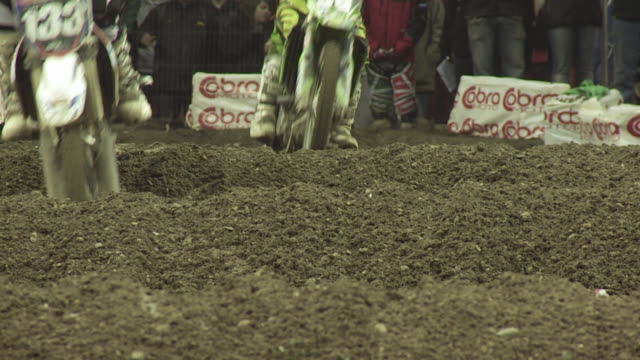 ms slo mo motorbike racing during off road race in arena venue / london, uk - off road racing stock videos and b-roll footage