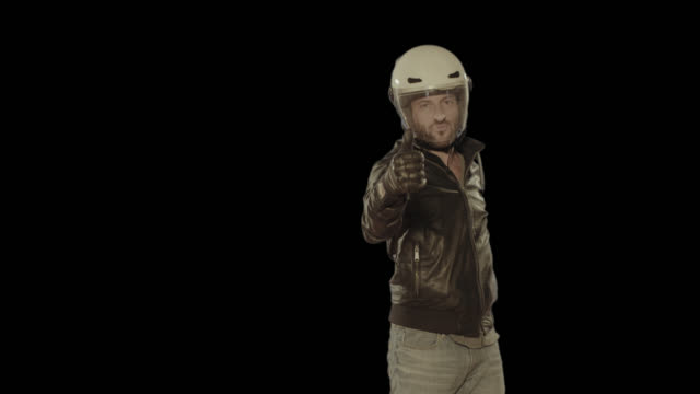 motorbike rider wearing helmet. isolated clip alpha channel available in 4k version - biker jacket stock videos and b-roll footage
