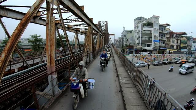 motorbike riders commuting to work long bien bridge - bridge built structure stock videos & royalty-free footage