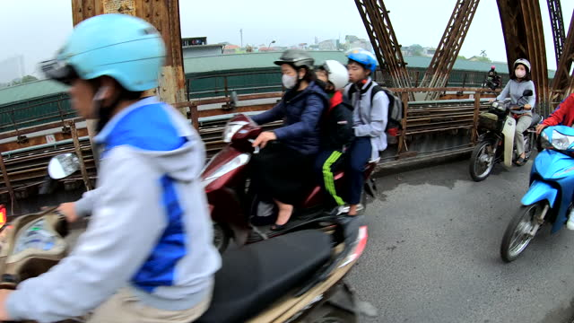 motorbike riders wearing pollution protective masks hanoi vietnam - bridge built structure stock videos & royalty-free footage