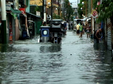 motorbikes driving through flood waters in cupang in aftermath of typhoon mirinae, philippines, 2009 - sidecar stock videos & royalty-free footage