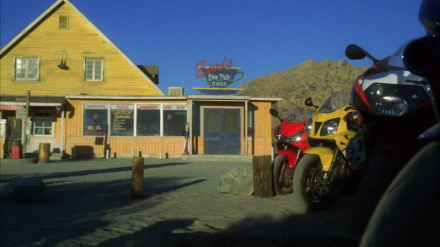 ws motorbikes parked in front of diner - wide shot stock videos & royalty-free footage