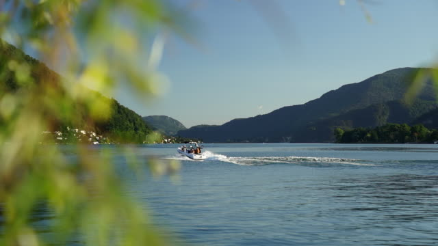 motorboat accelerating on alpine lake - ticino canton stock videos and b-roll footage