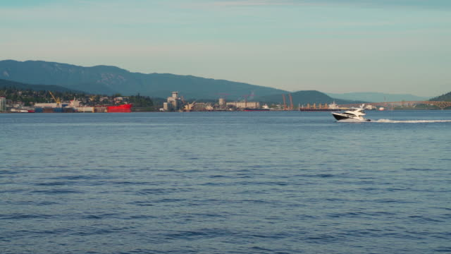 motorboat crossing vancouver harbor - town stock videos & royalty-free footage