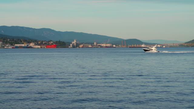 motorboat crossing vancouver harbor - coastline stock videos & royalty-free footage