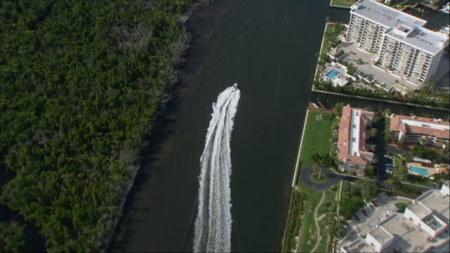 AERIAL, Motorboat on canal, Miami, Florida, USA