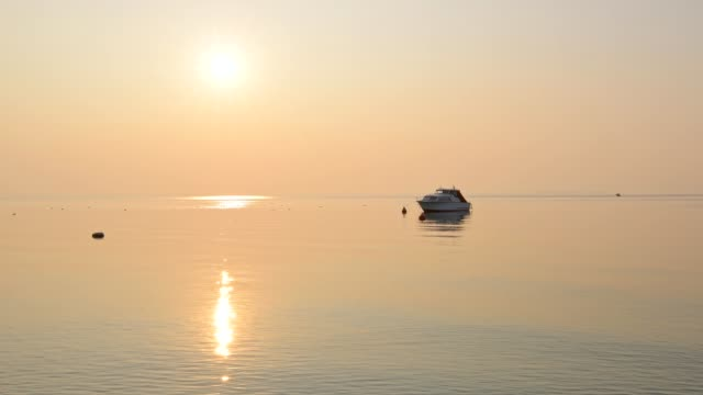 motorboat on lake garda at sunset, lazise, verona, lake garda, lago di garda, veneto, italy - lago stock videos & royalty-free footage