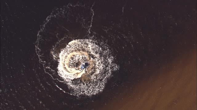 Motorboat spirals in estuary, Tasmania