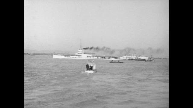 / motorboat with american flag on back moves towards the uss panay that has been bombed / other small boats move towards the smoking american gunboat... - 1937 stock videos & royalty-free footage