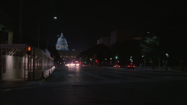 ts motorcade at night, with headlights and flashing emergency lights, leaving the illuminated u.s. capitol building and passing the lincoln memorial / washington, d.c., united states - motorcade stock videos & royalty-free footage