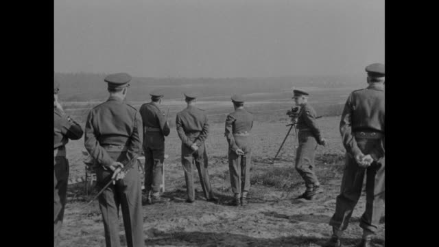 motorcade bearing philip duke of edinburgh approaches as it drives on dusty road in germany / duke decars greets officers / duke walks talks with... - regiment stock videos and b-roll footage