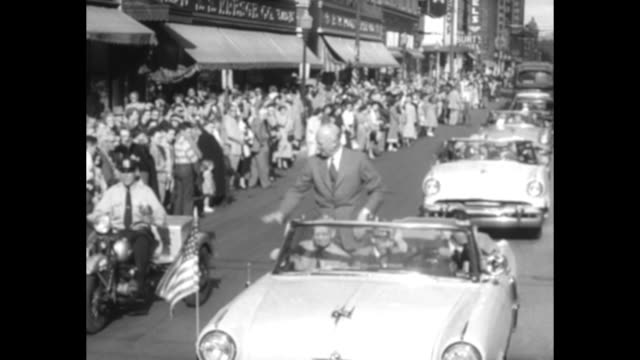 motorcade in business district of city with republican presidential candidate dwight eisenhower enthusiastically waving from atop convertible / large... - presidential candidate stock videos & royalty-free footage