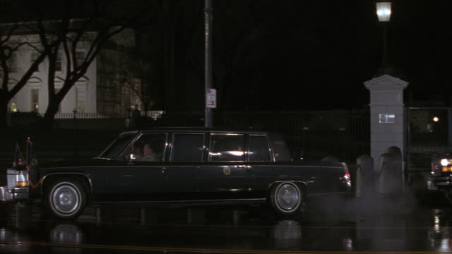 ms motorcade on rainy city street with lights and police cars / washington d.c., united states - limousine stock videos & royalty-free footage