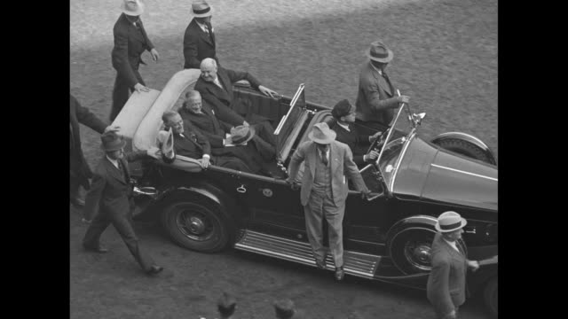 motorcade with car carrying pres franklin roosevelt driving around outside of infield at the polo grounds as vo crowd cheers whistles applauds /... - eastern usa stock videos and b-roll footage