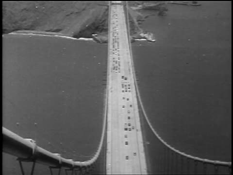 overhead motorcades on opposite ends driving onto golden gate bridge at opening / sf - 1937 stock-videos und b-roll-filmmaterial