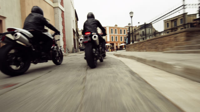 motorcycle chase scene - pursuit concept stock videos and b-roll footage