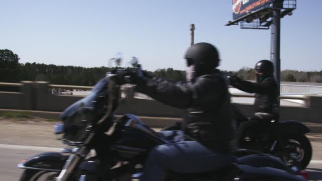 motorcycle club members drive on highway - biker gang stock videos & royalty-free footage