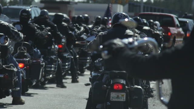 motorcycle club sits in traffic, close up - biker gang stock videos & royalty-free footage