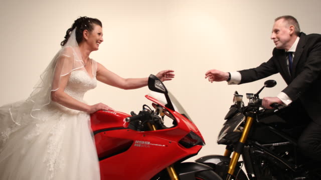 A motorcycle couple in a photo studio
