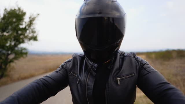 motorcycle driver starting his bike - leather jacket stock videos & royalty-free footage