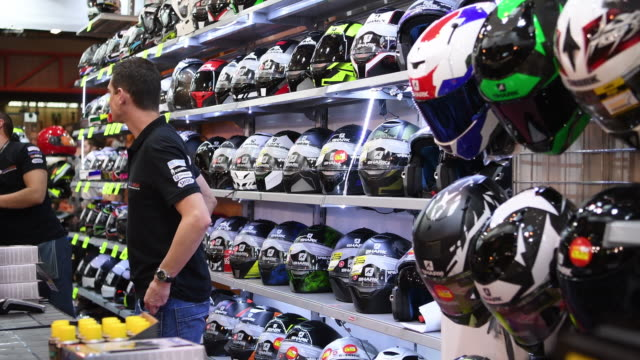 'motorcycle live' show on november 19, 2016 in birmingham, england. the show features the latest bikes, equipment and gadgets for motorcycle fans and... - crash helmet stock videos & royalty-free footage