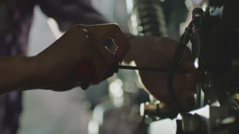 ecu. motorcycle mechanic twists hex key tool in auto shop. - manual worker stock videos & royalty-free footage