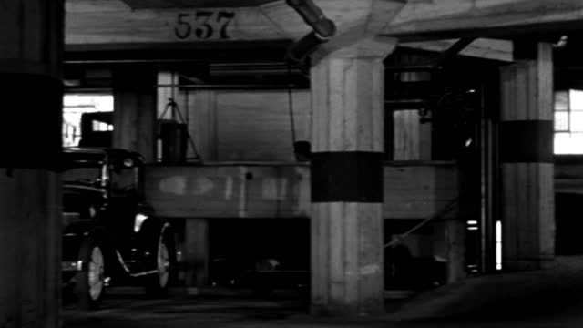 a motorcycle policeman drives up the ramp in a parking garage in 1935. - 1935 stock videos & royalty-free footage