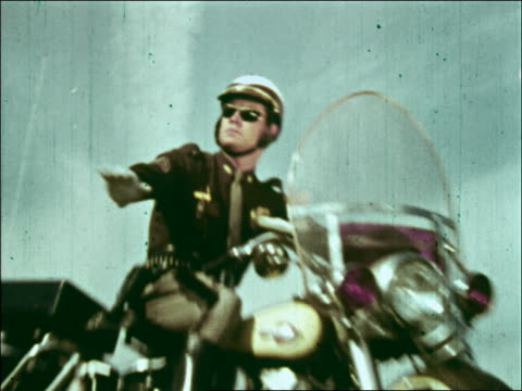 motorcycle policeman signals for car to stop - 2001 stock-videos und b-roll-filmmaterial