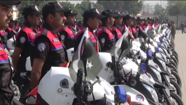 motorcycle policemen ride their motorcycles during their graduation ceremony at the police training center in lahore, pakistan on march 24, 2016.... - lahore pakistan stock-videos und b-roll-filmmaterial